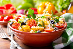 Bowl of pasta salad with vegetables Stock Image