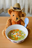Bowl of pasta soup. Teddy bear hold bowl of pasta soup Stock Photos