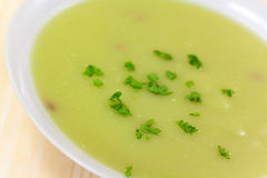 Bowl of pea soup garnished with  cream and crouton Stock Photo