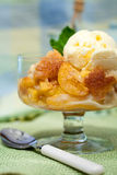 A Bowl Of Peach Cobbler With Vanilla Ice Cream Royalty Free Stock Photos