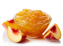 Bowl of peach jam Stock Images