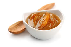 Bowl of peach jam. On white royalty free stock images
