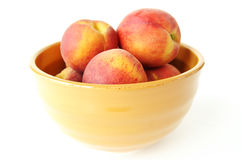 Bowl of peaches. A still life of a bowl full of ripe peaches royalty free stock photography