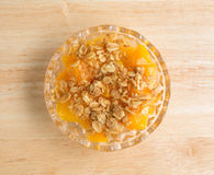 Bowl of peaches with brown sugar and oats on counter top Royalty Free Stock Images