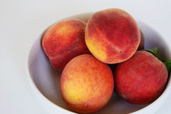 Bowl of peaches Stock Photo