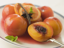 Bowl of Peaches Poached in Sauternes Wine Royalty Free Stock Photos