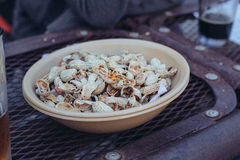 Bowl of peanut shells Stock Image