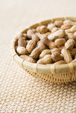 Bowl of peanuts, close-up Stock Images