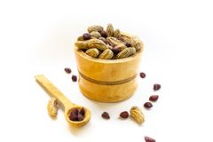 Bowl with peanuts in shell on white background stock image