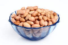 Bowl of peanuts with skin Royalty Free Stock Image