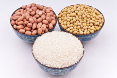 A bowl of peanuts, soybeans and rice Royalty Free Stock Photo