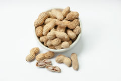 Bowl of peanuts on white background Royalty Free Stock Image
