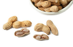 Bowl of peanuts on white background Royalty Free Stock Photography