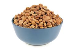 Bowl of peanuts on a white background royalty free stock photography