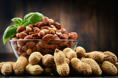 Bowl with peanuts on wooden table. Royalty Free Stock Photo