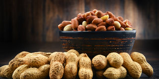 Bowl with peanuts on wooden table. Stock Image