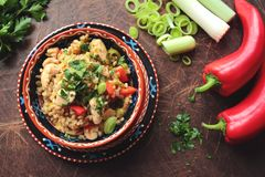 Bowl with pearl barley, vegetables and chicken Stock Images