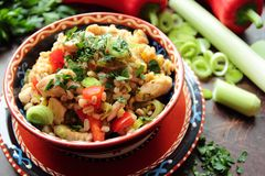 Bowl with pearl barley, vegetables and chicken Stock Image