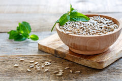 Image result for sunflower seeds on blue wooden table