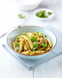 Bowl of penne with basil pesto Royalty Free Stock Photos
