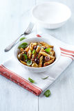 Penne with dried tomato pesto, olives and herbs Stock Photos