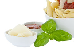 Bowl with penne and seperate sauce and cheese Royalty Free Stock Image