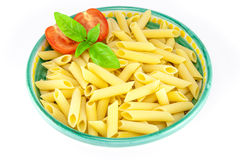 Bowl of pens pasta with tomatoes and basil Stock Photography
