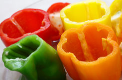 Bowl of peppers tops cut off stock image