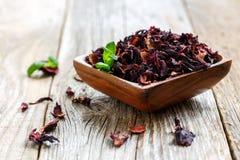 Bowl with petals of hibiscus tea Stock Photo