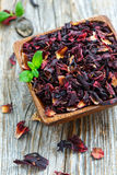 Bowl with petals of hibiscus tea. Royalty Free Stock Photography
