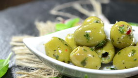 Bowl with pickled Green Olives (loopable) Stock Photos