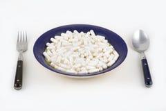 Bowl of pills Royalty Free Stock Photos