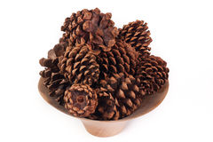 Bowl of pine cones isolated on a white background Royalty Free Stock Images
