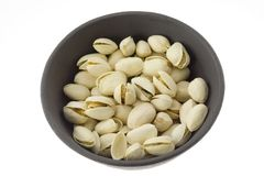 Bowl of pistachio nut Stock Photos