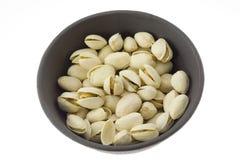 Bowl of pistachio nut Stock Photos