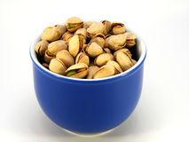 A bowl of pistachio nuts Stock Photo
