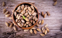 Bowl of pistachio nuts. Pistachio nuts Concept and Decoration stock photography