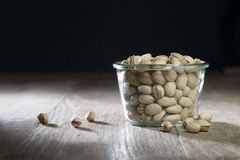 Bowl of pistachio nuts. Stock Photos