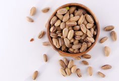 Bowl of pistachio nuts wood background. Pistachio nuts Concept and Decoration stock image