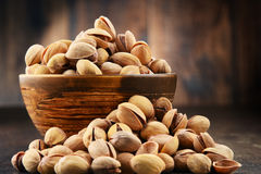 Bowl with pistachio on wooden table Royalty Free Stock Photography