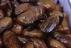 Bowl of pitted dates , top view stock images