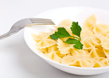 A bowl of plain butterfly pasta Stock Photos