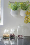 Bowl of plants hang on bar rail with glass vase Stock Photos