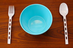 Bowl with plastic spoon and fork Stock Photos