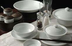 Bowl and plate 1. Variety of dishes, utensils, and glassware royalty free stock photography
