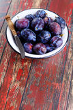 Bowl of plums Stock Images