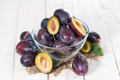 Bowl with Plums Stock Image