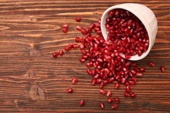Bowl with pomegranate seeds Stock Image