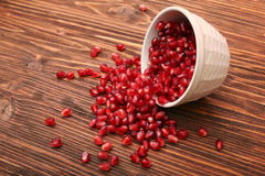 Bowl with pomegranate seeds Stock Photo