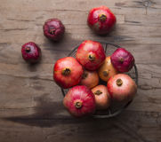Bowl of pomegranates on a wooden table Stock Photography